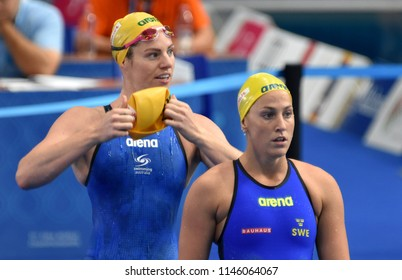 Budapest, Hungary - Jul 26, 2017. Competitive swimmer LINDBORG Ida (SWE) and SEEBOHM Emily (AUS) swimming 50m backstroke. FINA Swimming World Championship Preliminary Heats in Duna Arena.