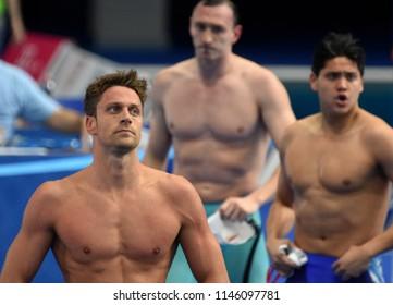 Budapest, Hungary - Jul 26, 2017. Competitive swimmer SCHOOLING Joseph (SGP) and DOTTO Luca (ITA) swimming 100m freestyle. FINA Swimming World Championship Preliminary Heats in Duna Arena.