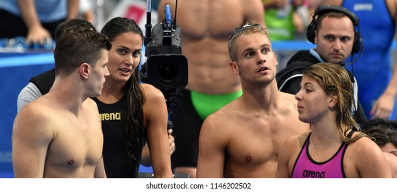 Budapest, Hungary - Jul 26, 2017. Team Hungary (GYURTA Daniel, JAKABOS Zsuzsanna, BALOG Gabor, SZILAGYI Liliana) in the Mixed 4x100m Medley Relay. FINA Swimming World Championship Preliminary Heats.