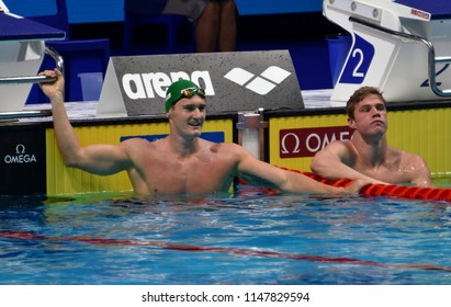 Budapest, Hungary - Jul 26, 2017. Competitive swimmer VAN DER BURGH Cameron (RSA) and CORDES Kevin (USA) in the 50m breaststroke Final. FINA Swimming World Championship was held in Duna Arena.