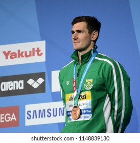 Budapest, Hungary - Jul 26, 2017. Competitive swimmer VAN DER BURGH Cameron (RSA) at the Victory Ceremony of the Men's 50m breaststroke. FINA Swimming World Championship was held in Duna Arena.