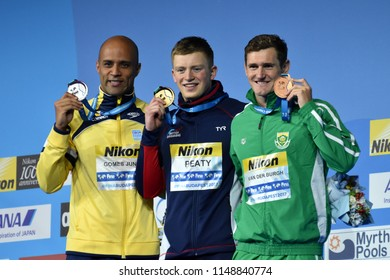 Budapest, Hungary - Jul 26, 2017. GOMES JUNIOR Joao (BRA), winner PEATY Adam (GBR) and VAN DER BURGH Cameron (RSA) at Victory Ceremony of the Men's 50m breaststroke. FINA Swimming World Championship.