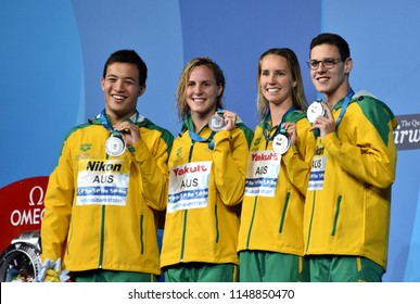 Budapest, Hungary - Jul 26, 2017. Team  Australia (LARKIN Mitchell, CAVE Daniel, MCKEON Emma, CAMPBELL Bronte) at the Victory Ceremony of Mixed 4x100m Medley Relay Final. Fina Swimming World Championship.