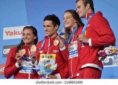 Budapest, Hungary - Jul 26, 2017. Team  Canada (MASSE Kylie Jacqueline, FUNK Richard, OLEKSIAK Penny, KISIL Yuri) at the Victory Ceremony of Mixed 4x100m Medley Relay. Fina Swimming World Championship.
