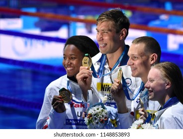 Budapest, Hungary - Jul 26, 2017. Winning team  USA (GREVERS Matt, KING Lilly, DRESSEL Caeleb Remel, MANUEL Simone) at Victory Ceremony of Mixed 4x100m Medley Relay Final. Fina Swimming World Championship