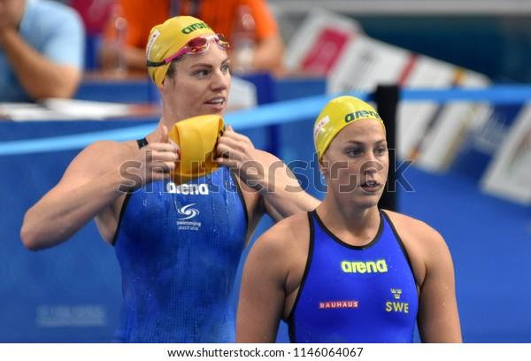 Budapest, Hungary - Jul 26, 2017. Competitive swimmer LINDBORG Ida (SWE) and SEEBOHM Emily (AUS) swimming 50m backstroke. FINA Swimming World Championship Preliminary Heats in Duna Arena.
