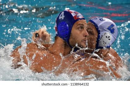 Budapest, Hungary - Jul 27, 2017. RANDELOVIC Sava (SRB, cap 4) fights against LONCAR Luka (CRO, cap 4). FINA Waterpolo World Championship, Semifinal.