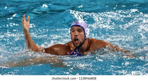 Budapest, Hungary - Jul 27, 2017. UBOVIC Nemanja (SRB, cap 7) fights against MACAN Marko (CRO, cap 2). FINA Waterpolo World Championship, Semifinal.