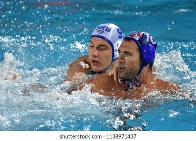 Budapest, Hungary - Jul 27, 2017. KRAPIC Ivan (CRO, cap 10) fights against JAKSIC Nikola (SRB, cap 9). FINA Waterpolo World Championship, Semifinal.