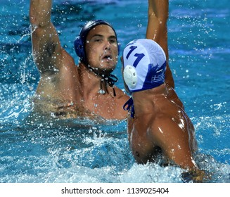 Budapest, Hungary - Jul 27, 2017. HOSNYANSZKY Norbert (6) hungarian waterpolo player fights against GOUNAS Alexandros (GRE, cap 11). FINA Waterpolo World Championship, Semifinal.