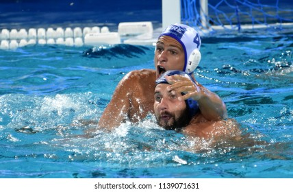 Budapest, Hungary - Jul 27, 2017. MEZEI Tamas (HUN, cap 11) fights against DERVISIS Georgios (GRE, cap 4). FINA Waterpolo World Championship, Semifinal.