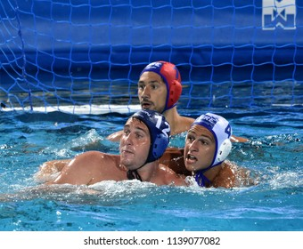 Budapest, Hungary - Jul 27, 2017. HARAI Balazs (HUN, cap 12) fights against DERVISIS Georgios (GRE, cap 4). FINA Waterpolo World Championship, Semifinal.