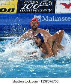 Budapest, Hungary - Jul 27, 2017. GOR-NAGY Miklos (8) and NAGY Viktor (1) defend against Greece Waterpolo Team. FINA Waterpolo World Championship, Semifinal.