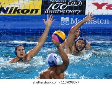 Budapest, Hungary - Jul 27, 2017. GOR-NAGY Miklos (8), VAMOS Marton (5) and NAGY Viktor (1) defend against Greece Waterpolo Team. FINA Waterpolo World Championship, Semifinal.