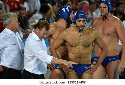 Budapest, Hungary - Jul 27, 2017. GERENDAS Gyorgy, MARCZ Tamas head coach with GOR-NAGY Miklos (8), TOROK Bela (2) and MEZEI Tamas (11). FINA Waterpolo World Championship, Semifinal.