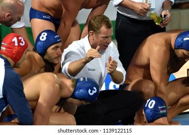 Budapest, Hungary - Jul 27, 2017. MARCZ Tamas head coach with his players (MANHERCZ Krisztian 3, GOR-NAGY Miklos 8, DECKER Attila 13, DECKER Adam 7). FINA Waterpolo World Championship, Semifinal.