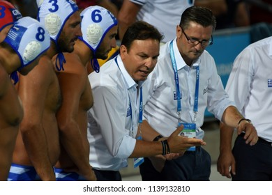Budapest, Hungary - Jul 27, 2017. VLACHOS Theodoros head coach and the greek men waterpolo team in the Semifinal. FINA Waterpolo World Championship was held in Alfred Hajos Swimming Centre in 2017.