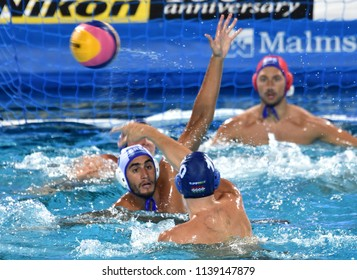 Budapest, Hungary - Jul 27, 2017. KAPOTSIS Marios (6) and FLEGKAS Konstantinos (1) defend against VARGA Denes (10). FINA Waterpolo World Championship, Semifinal.