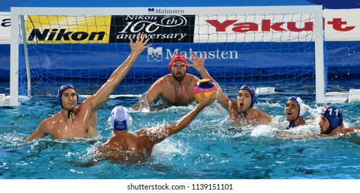 Budapest, Hungary - Jul 27, 2017. MEZEI Tamas (11), ERDELYI Balazs (9), VAMOS Marton (5) and NAGY Viktor (1) defend against FOUNTOULIS Ioannis (5). FINA Waterpolo World Championship, Semifinal.