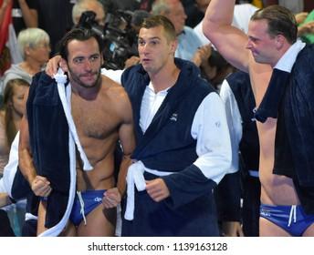 Budapest, Hungary - Jul 27, 2017. Happy hungarian team (GOR-NAGY Miklos 8, DECKER Attila 13, TOROK Bela 2) after winning in the Semifinal. FINA Waterpolo World Championship.