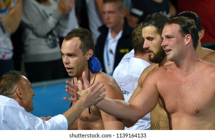 Budapest, Hungary - Jul 27, 2017. Happy hungarian team (ERDELYI Balazs 9, TOROK Bela 2, MEZEI Tamas 11) after winning in the Semifinal. FINA Waterpolo World Championship.