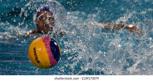 Budapest, Hungary - Jul 27, 2017. Waterpolo player swimming with the ball.