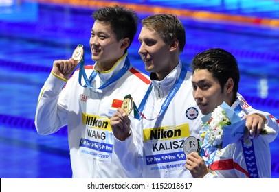 Budapest, Hungary - Jul 27, 2017. WANG Shun (CHN), HAGINO Kosuke (JPN) and the winner KALISZ Chase (USA) at the Victory Ceremony of the Men 200m Individual Medley. FINA Swimming World Championship.