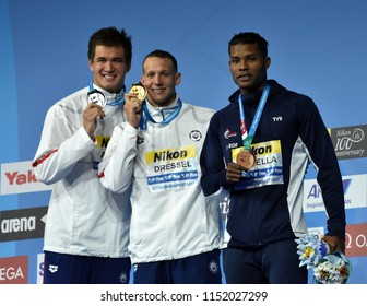 Budapest, Hungary - Jul 27, 2017. METELLA Mehdy (FRA), ADRIAN Nathan (USA) and the winner DRESSEL Caeleb Remel (USA) at the Victory Ceremony of the Men 100m Freestyle. FINA Swimming World Championship