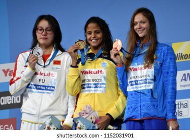 Budapest, Hungary - Jul 27, 2017. HERASIMENIA Aliaksandra (BLR), FU Yuanhui (CHN) and winner MEDEIROS Etiene (BRA) at the Victory Ceremony of the Women 50m Backstroke. FINA Swimming World Championship