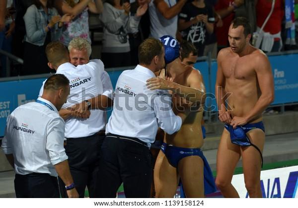 Budapest, Hungary - Jul 27, 2017. Happy hungarian team (MARCZ Tamas, GERENDAS Gyorgy, VARGA Denes 10, ERDELYI Balazs 9) after winning in the Semifinal. FINA Waterpolo World Championship.