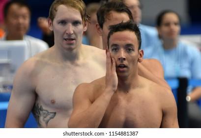 Budapest, Hungary - Jul 28, 2017. Competitive swimmer TAKACS Krisztian (HUN) and BILIS Simonas (LTU) after swimming 50m Freestyle. FINA Swimming World Championship Preliminary Heats in Duna Arena.