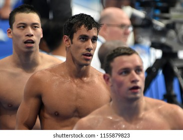 Budapest, Hungary - Jul 28, 2017. LEMESHKO Liubomyr (UKR), MARTINS Henrique (BRA) and LI Zhuhao (CHN) after swimming 100m butterfly. FINA Swimming World Championship Preliminary Heats in Duna Arena.