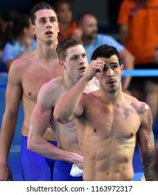Budapest, Hungary - Jul 28, 2017. FRATUS Bruno (BRA), JURASZEK Pawe (POL) and GKOLOMEEV Kristian (GRE) after the 50m Freestyle SemiFinal. FINA Swimming World Championship was held in Duna Arena.