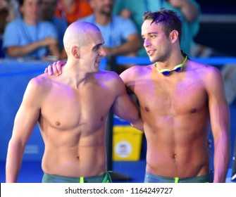Budapest, Hungary - Jul 28, 2017. Competitive swimmer CSEH Laszlo (HUN) and LE CLOS Chad (RSA) after the 100m Butterfly SemiFinal. FINA Swimming World Championship was held in Duna Arena.