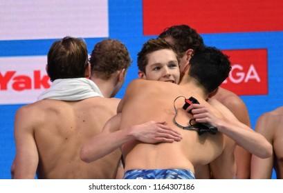 Budapest, Hungary - Jul 28, 2017. Team GBR (SCOTT Duncan, James GUY) win the Men 4x200m Freestyle Final. FINA Swimming World Championship in Duna Arena.
