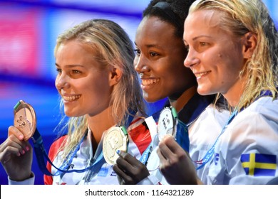 Budapest, Hungary - Jul 28, 2017. BLUME Pernille (DEN), SJOSTROM Sarah (SWE) and the winner MANUEL Simone (USA) at the Victory Ceremony of the Women 100m Freestyle. FINA Swimming World Championship.