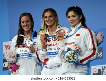 Budapest, Hungary - Jul 28, 2017. SHI Jinglin (CHN), GALAT Bethany (USA), and the winner EFIMOVA Yuliya (RUS) at the Victory Ceremony of the Women 200m Breaststroke. FINA Swimming World Championship.