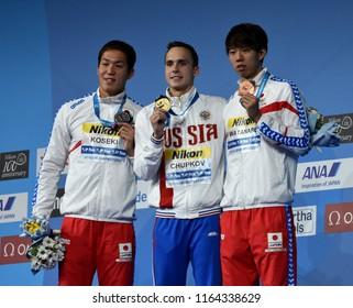 Budapest, Hungary - Jul 28, 2017. WATANABE Ippei (JPN), KOSEKI Yasuhiro (JPN) and the winner CHUPKOV Anton (RUS) at the Victory Ceremony of the Men 200m Breaststroke. FINA Swimming World Championship.