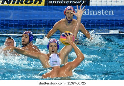 Budapest, Hungary - Jul 29, 2017.  Croatia (BIJAC Marko 1, JOKOVIC Maro 5, BULJUBASIC Ivan 6) play against Hungary (VARGA Denes 10, HARAI Balazs 12). FINA Waterpolo World Championship, Final.