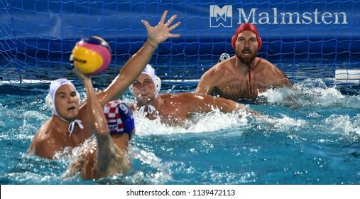 Budapest, Hungary - Jul 29, 2017. Hungary (NAGY Viktor 1, HOSNYANSZKY Norbert 6, TOROK Bela 2) defend against Croatia (SUKNO Sandro 9) in the Final. FINA Waterpolo World Championship.