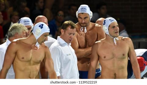 Budapest, Hungary - Jul 29, 2017. MARCZ Tamas head coach and the hungarian men waterpolo team (MANHERCZ Krisztian 3, ZALANKI Gergo 4, DECKER Adam 7). FINA Waterpolo World Championship, Final, HUN-CRO.