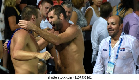 Budapest, Hungary - Jul 29, 2017. Happy croatian team and coach (TUCAK Ivica) after winning in the Final against Hungary. FINA Waterpolo World Championship was held in Alfred Hajos Swimming Centre.