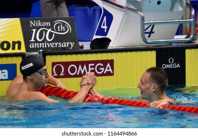 Budapest, Hungary - Jul 29, 2017. Competitive swimmer DRESSEL Caeleb Remel (USA) and GUY James (GBR) after the 100m Butterfly Final. FINA Swimming World Championship was held in Duna Arena.