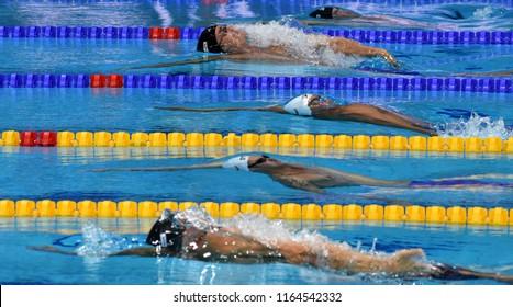 Budapest, Hungary - Jul 29, 2017. LACOURT Camille (FRA), KOPELEV Jonatan Josef (ISR) and SANKOVICH Pavel (BLR) in the 50m Backstroke SemiFinal. FINA Swimming World Championship was held in Duna Arena.