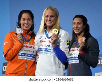 Budapest, Hungary - Jul 29, 2017. KROMOWIDJOJO Ranomi (NED), OSMAN Farida (EGY) and winner SJOSTROM Sarah (SWE) at the Victory Ceremony of the Women 50m Butterfly. FINA Swimming World Championship.