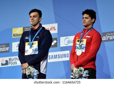 Budapest, Hungary - Jul 29, 2017. Bronze medalists SCHOOLING Joseph (SGP) and GUY James (GBR) at the Victory Ceremony of the Men 100m Butterfly. FINA Swimming World Championship.