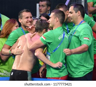 Budapest, Hungary - Jul 30, 2017. VERRASZTO David (HUN) and his coach team celebrate the Silver medal after the 400m Individual Medley Final. FINA Swimming World Championship was held in Duna Arena.