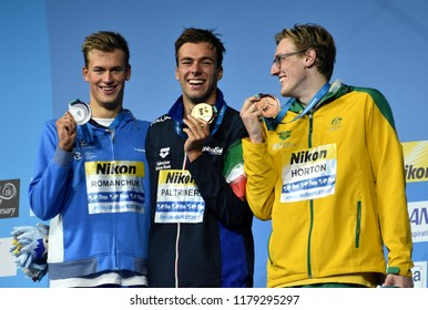 Budapest, Hungary - Jul 30, 2017. HORTON Mack (AUS), winner PALTRINIERI Gregorio (ITA) and ROMANCHUK Mykhailo (UKR) at the Victory Ceremony of the Men 1500m Freestyle. FINA Swimming World Championship