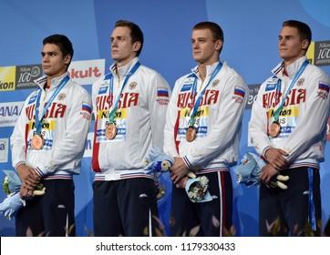 Budapest, Hungary - Jul 30, 2017. Bronze medalist Russia (RYLOV Evgen, PRIGODA Kirill, POPKOV, MOROZOV) at the Victory Ceremony of the Men 4x100m Medley Relay. FINA Swimming World Championship.