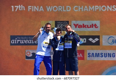Budapest, Hungary - Jul 30, 2017.  NAVRATIL Michal  (CZE), LO BUE Steve (USA) and DE ROSE Alessandro (ITA), the winners of the Men's High Diving Competition. FINA High Diving World Campionships.